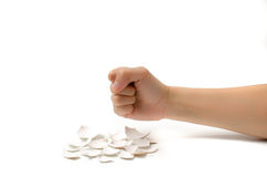 Fist over eggshells. Image of power juxtaposed over fragility Stock Images