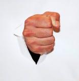 Fist through paper Stock Photos