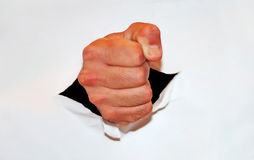 Fist through paper Royalty Free Stock Photos