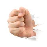 fist paper punching thru Στοκ εικόνες με δικαίωμα ελεύθερης χρήσης