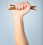 Fist with pencils Stock Photography