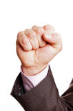 Fist pump. A suited man pumping fist on white background Stock Images