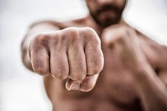 Fist punch. knockout and energy. Sport is our life. no pain no gain. Great progress. success and prigress. strong man. Punch with huge power. absolute winner stock photography