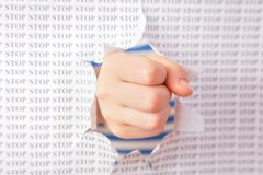 Fist punch through paper Stock Images