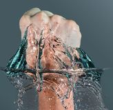Fist punch. / punching through water in this power / break through concept Stock Photography