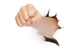 Fist punching through Royalty Free Stock Photo