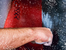 Fist and punching bag Royalty Free Stock Images
