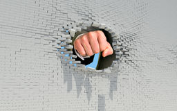 Fist punching through brick wall Royalty Free Stock Photo