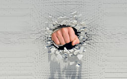 Fist punching through a brick wall Royalty Free Stock Photo