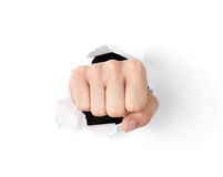 Fist punching through the hole Royalty Free Stock Photography