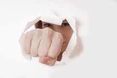 Fist punching hole royalty free stock photo
