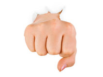Fist punching paper Stock Image