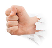 Fist punching paper Royalty Free Stock Photos