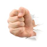 Fist punching thru paper Royalty Free Stock Images