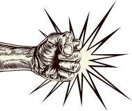 Fist punching wood cut Stock Images