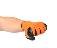 Fist in rubber orange glove. Royalty Free Stock Photo