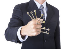 Fist and screws on hand of businessman in the suit concept const Stock Photography