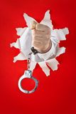 Fist in shackles Stock Photos