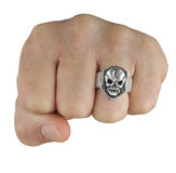 Fist with skull ring stock image