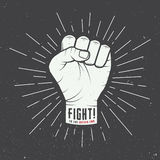 Fist with sunbursts in vintage style. Royalty Free Stock Images