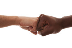Fist to Fist. Multiracial fist to fist agreement (isolated on white Stock Photo