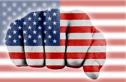 Fist with us flag. Fist with digitally painted flag of the us Stock Images