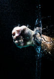 Fist through water Royalty Free Stock Image