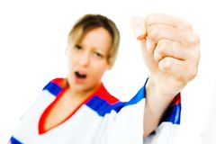 Fist of woman hockey fan in jersey in national color of Russia cheer. Celebrating goal - white background stock photo
