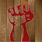 Fist on wooden planks Stock Photo