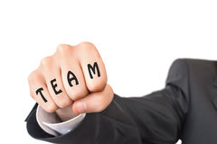 Fist with word team beats to camera. The concept of teamwork stock photo