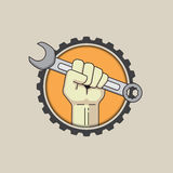 Fist with wrench on gear background. Vector illustration Royalty Free Stock Photo