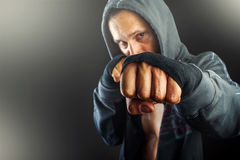 Fist of young dangerous man closeup Royalty Free Stock Image