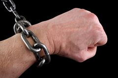 Fisted hand in shackles Royalty Free Stock Images
