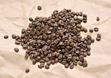 Fistful of coffee grains Royalty Free Stock Image