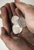 Fistful of Dollar coins Stock Photos