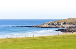 Fistral Beach Newquay. A green lawn and the sandy Fistral Beach in Newquay, Cornwall, England, with the open sea in the background royalty free stock photography