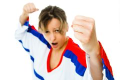 Fists up - woman hockey fan in jersey in national color of Russia cheer, celebrating goal. White background royalty free stock photography
