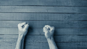 Fists on a wooden table Royalty Free Stock Photography
