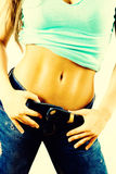 Fit abs. On a young girl body Stock Image