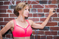 Fit active young woman in urban environment Royalty Free Stock Photo