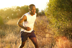 Fit african american man running outside stock photography
