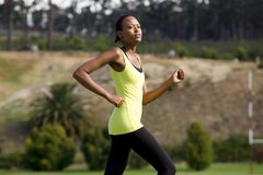 Fit african woman running outdoors Royalty Free Stock Photos