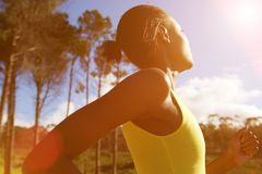 Fit african woman running outdoors on a sunny day Royalty Free Stock Photos