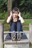 Fit asian female doing exercise Stock Photos