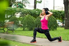 Fit Asian woman. Doing lunge exercise in park Stock Images
