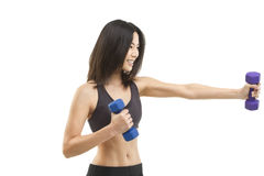 Fit Asian woman exercising. Beautiful Asian woman exercising with hand weights Stock Photos