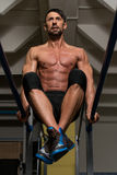 Fit Athlete Doing Exercise On Parallel Bars Stock Photo