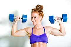 Fit athlete holding up dumbbell weights Stock Photos