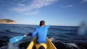 Fit athlete on kayak in open water