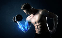 Fit athlete lifting weight with blue muscle light concept royalty free stock photo
